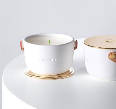 Louis Vuitton is selling $203 candles that look like purses, and there are even straps so you can carry them around