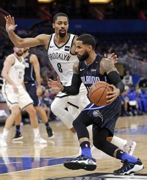 Russell scores 40 as Nets come back to beat Magic 117-115