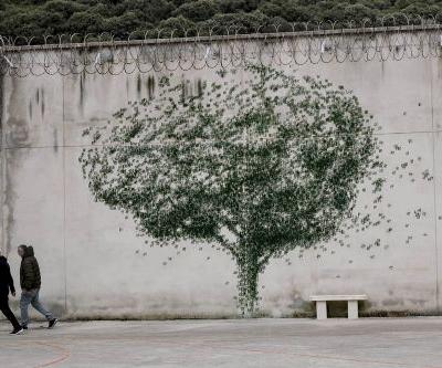 Pejac Partners with Inmates to Transform a Prison Into a Gold Mine