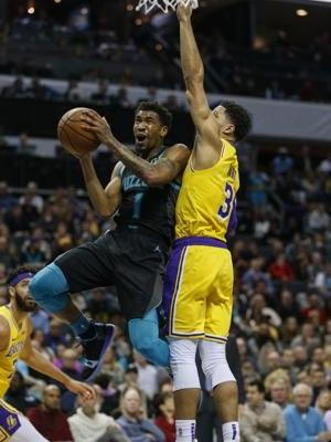 James, Ball post triple-doubles in 128-100 win over Hornets