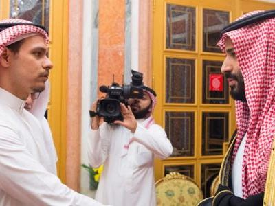 Staged photos show Khashoggi's son shaking hands with the Saudi Crown Prince, who many believe ordered his father's murder