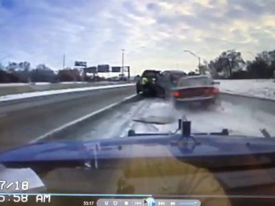 Caught on camera: Terrifying moment tow truck driver escapes disaster