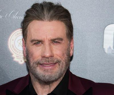 John Travolta rang in 2019 with a rugged beard - and a shaved head