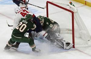 Suspension over early, Wilson helps lead Caps past Wild