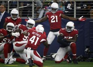 Coach says Cardinals will not trade Peterson, despite report