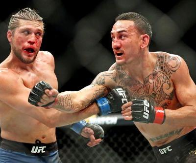 After UFC 231 win, Max Holloway open to lightweight move as Dana White recommends