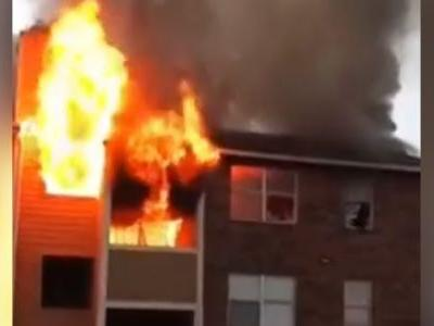 Woman in burning apartment drops baby to bystander, others jump from 3rd floor to safety, video shows