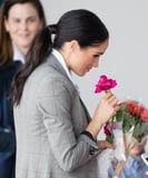 Meghan Markle Ditched Her Signature Messy Bun For a Rare Ponytail While on the Royal Tour