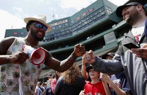 Martinez's 2 vastly different HRs lead Red Sox past O's 5-0