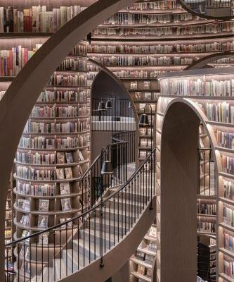 A Mirrored Ceiling and Gleaming Tile Floor Turn This Chinese Bookstore into an Immersive M.C. Escher-Style Illusion