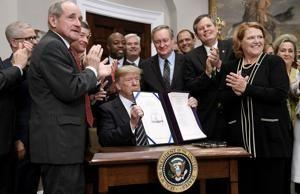 Trump signs bipartisan bill rolling back some Dodd-Frank bank regulations