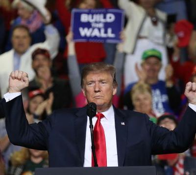 Trump saves face with base after bruising wall fight