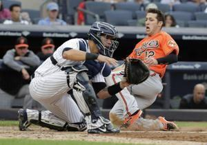Hicks, Yanks earn wild card with 11-inning win over Orioles