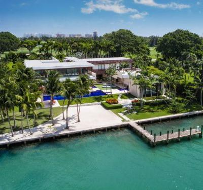 A glass mansion in Miami has set 2 real-estate records in the past 7 years - here's a look inside the $50 million estate