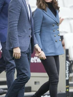 Kate Middleton Conceals Baby Bump in Chic Outfit at Surprise Appearance