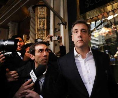 On his way to prison, former Trump attorney Michael Cohen says 'much to be told'