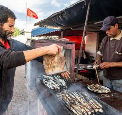 After a $500 meal at the world's most luxurious hotel, I stumbled across a $1 fish restaurant on the Moroccan coast - and I'd pick the cheaper one every time