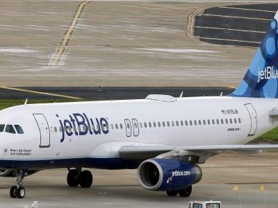 Armed police stormed a JetBlue aircraft after the pilot used the wrong radio code and accidentally sent a warning it was being hijacked