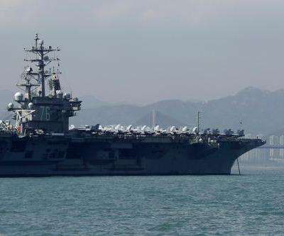 US aircraft carrier docks in Hong Kong after bombers fly over South China Sea