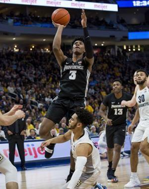Howard, Hausers, No. 15 Marquette beat Providence 79-68