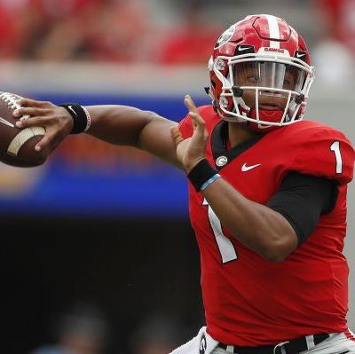 AP source: Georgia QB Fields visits Ohio State, may transfer