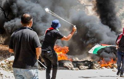 Israeli troops shoot dead Palestinian 15yo at clash in occupied West Bank, health ministry says
