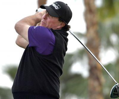 Phil Mickelson maintains lead thanks to late charge
