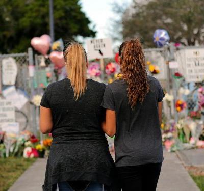 Dozens of airline employees went to the funeral for a Florida school shooting victim whose father is a United pilot