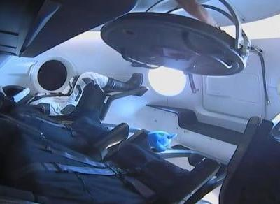 Watch an ISS astronaut enter the SpaceX crew capsule for the first time