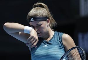 The Latest: Thriller of a coin toss at the Australian Open