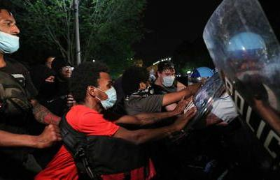 'Tear gas' sprayed as riot cops face off against angry crowd outside White House amid nationwide George Floyd protests