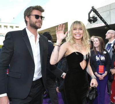 Miley Cyrus & Liam Hemsworth's Body Language At The 'Avengers' Premiere Is Confusing