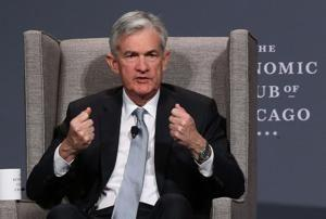Fed holds key interest rate steady; another hike next month appears likely