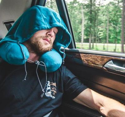 I spent 2 weeks traveling Europe by bus and this hooded neck pillow was a lifesaver for helping me get enough sleep