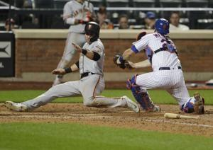 Mets botch popup in 13th, Giants wind up with 2-1 win