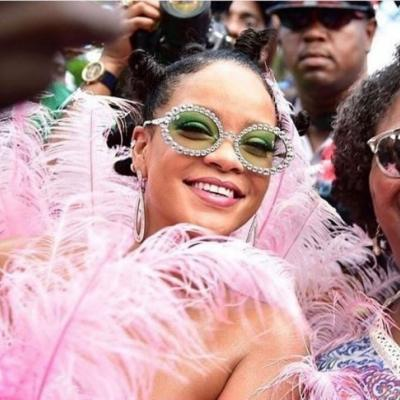 Rihanna is here to bless your feed with her pink feathered Carnival look