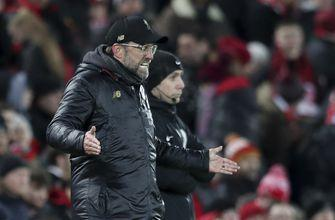 Liverpool extends lead to 5 points after draw with Leicester