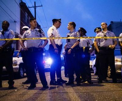 The attorney for a gunman suspected of shooting 6 Philadelphia police officers says he talked his client into surrendering in a phone call. The police commissioner says the standoff ended with tear gas