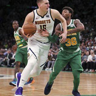 Nuggets clinch playoff spot with win over Celtics