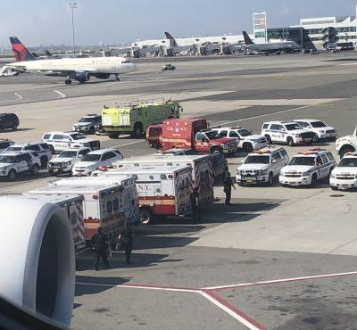A Harvard doctor says the dozens of passengers sickened on international flights are a clear 'warning shot' of a worst-case scenario