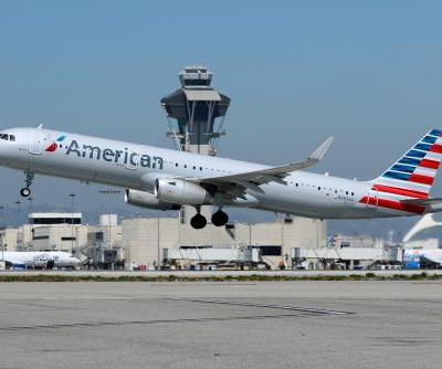An American Airlines flight attendant is suing the airline for $1 million dollars after another crew member allegedly assaulted her with a scarf and dragged her down the aisle