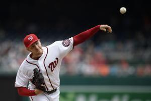 Corbin earns 1st win with Nationals, beats Giants 4-2