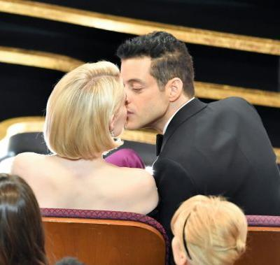 Rami Malek & Lucy Boynton Kissed from the Front Row of the Oscars & It Was So Cute