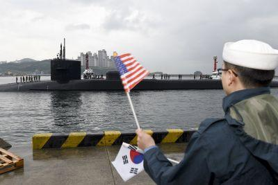 North Korea reportedly conducts live-fire exercise as US sub docks in the South