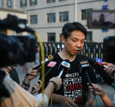 Chinese relatives of missing MH 370 passengers reject report's findings, demand search be restarted