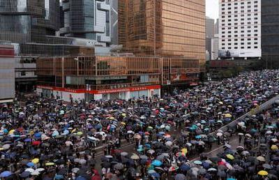 Scuffles as 10,000s of protesters march in Hong Kong to oppose extradition bill