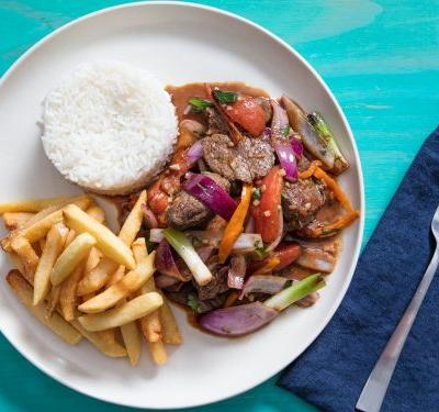 Lomo Saltado (Peruvian Stir-Fried Beef With Onion, Tomatoes, and French Fries)