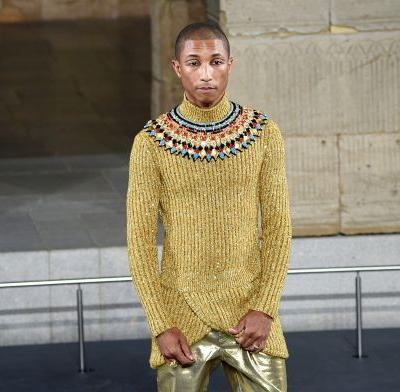 Pharrell glittered in gold on the Chanel runway