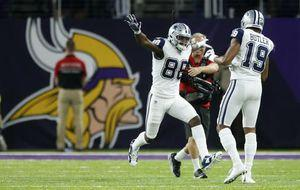 Cowboys keep on rolling, hold off Vikings late