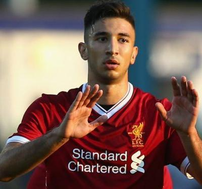 Liverpool's Grujic travels to Germany to complete loan
